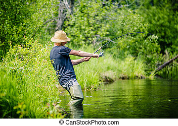 Young Fisherman Catching a big Fish