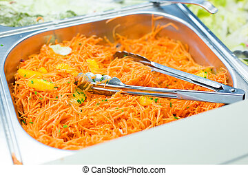 close up of spicy korean carrot salad in container - food,...