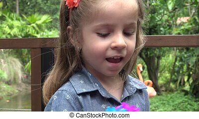 Toddler Receives Gift of Flowers