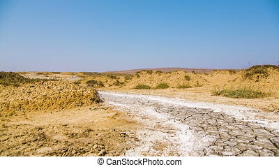 Desert Road With Hardened Volcano Mud At The Valley - Dolly...