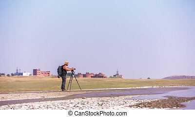 Cameraman Making Video At Mud Volcano Valley, Crimea - In...