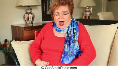 Woman having abdominal pain - Painful mature woman sitting...