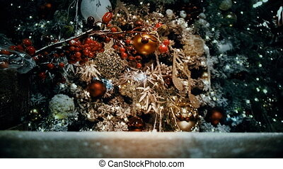 A Fragment of a Christmas tree decorated with toys and garlands