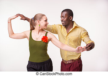 Young couple dances Caribbean Salsa, studio shot - Young...