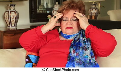 Mature woman having headache - Mature woman suffering a...