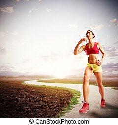 Run on a path - Woman runs on a path to sunlight