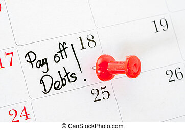 The words Pay off Debts written. - The words Pay off Debts...