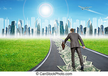 Man on money road leading to city