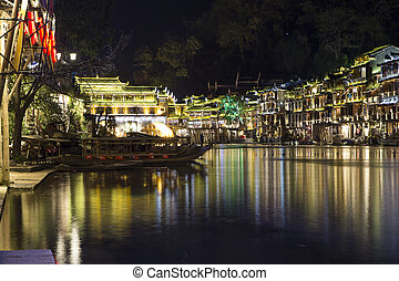 Feng Huang at night, ancient city in Hunan, China December...