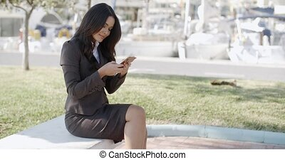 Woman Holding A Phone On The Street - Business woman holding...