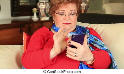 Mature woman using smart phone - Portrait of modern senior...