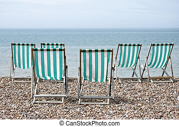 Six Deckchairs Facing Sea - Rear view of six turquise and...