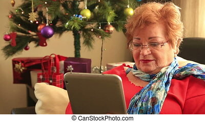 Woman using the digital tablet - Portrait of mature woman...