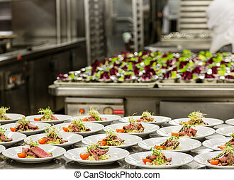 Appetizer Prep in Commercial Kitchen - Many plates of...