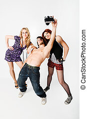 Three youngsters at the studio doing a photoshoot