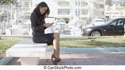 Young Businesswoman With Smartphone - Elegant woman texting...