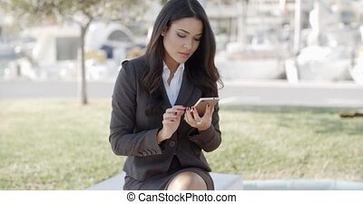 Businesswoman Using Phone On The Street - Young business...