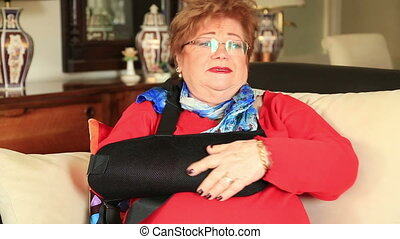 Mature woman with a broken arm - Painful senior woman with...