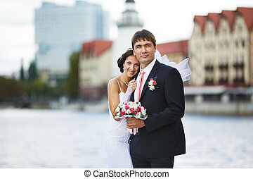 Wedding couple on riverside - Wedding couple walking on the...