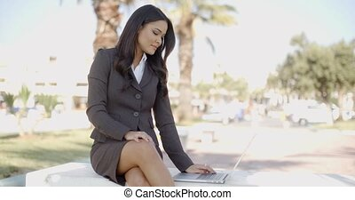 Business Woman With Laptop Sitting On The Bench - Beautiful...