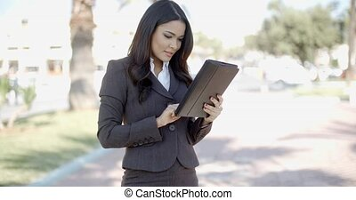 Businesswoman Using Tablet Outdoors - Portrait of...