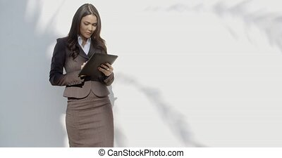Young Woman Using Tablet Outdoors - Business woman holding...