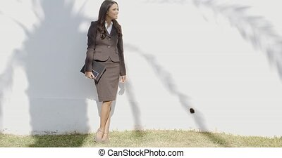Business Woman Staying In Front Of A Wall - Business woman...