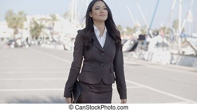 Woman Walking Along The Quay With Yachts - Young business...