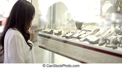 Woman Looking At The Shop Window - Close up view of girl...