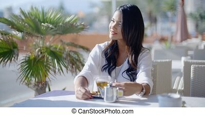 Woman Waiting For Friend In Cafe - Outdoor portrait of young...