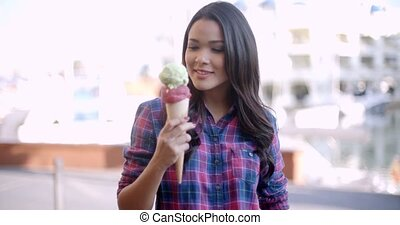 Young Girl Eating Ice Cream - Young girl eating ice cream on...