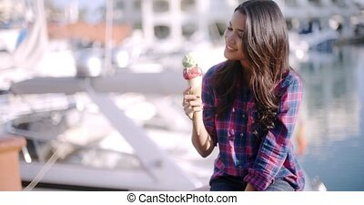 Woman Enjoying Ice Cream On Vacation - Woman on the street...
