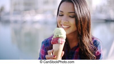 Girl Eating A Delicious Ice Cream - Girl eating a delicious...