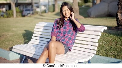 Beautiful Woman At The Park - Beautiful young girl sitting...