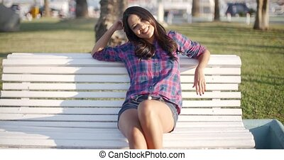 Girl Relaxing On Bench In Park
