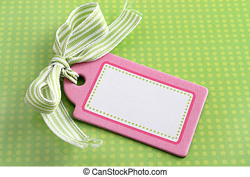 Blank pink tag on green