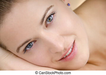beautiful face woman lying on soft blanket in studio