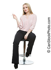 Elegant beautiful woman sitting on a contemporary metal bar...