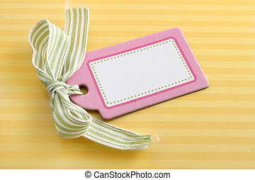Blank pink tag on yellow