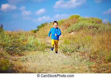 happy kid running the summer field