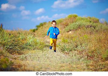 happy kid running the summer field