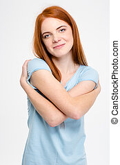 Attractive sensual smiling young woman hugging herself -...