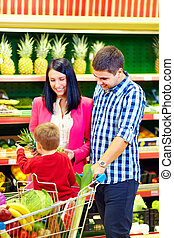 family buying healthy food in supermarket
