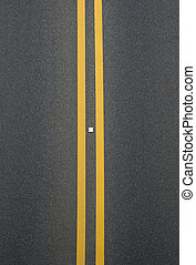 double yellow lines divider on blacktop