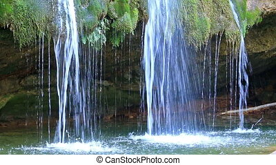Beautiful veil cascading waterfalls in Campdevanol, Spain