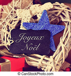 ornaments and text joyeux noel, merry christmas in french -...