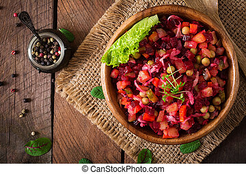 Beet salad Vinaigrette in a wooden bowl. Top view
