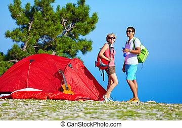 young people camping in mountains