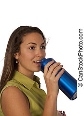 Woman drinking in blue bottle of water over white background