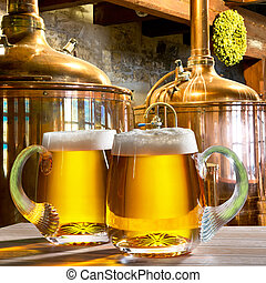 two beers in the brewery - two glass of beer in the brewery